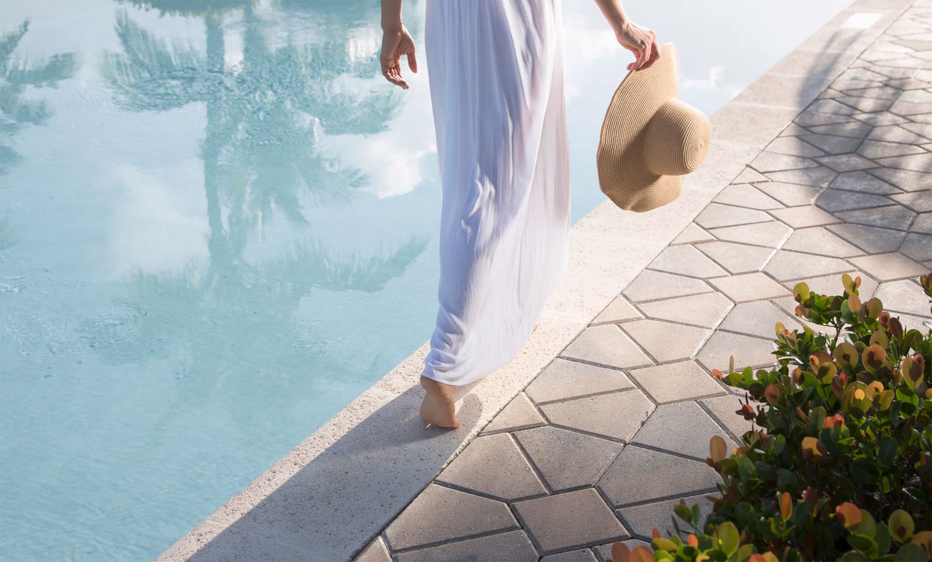 A Woman Walking Isla Bella's Beautiful New Contemporary 199-suite, 24-Acre Resort in the Heart of the Florida Keys