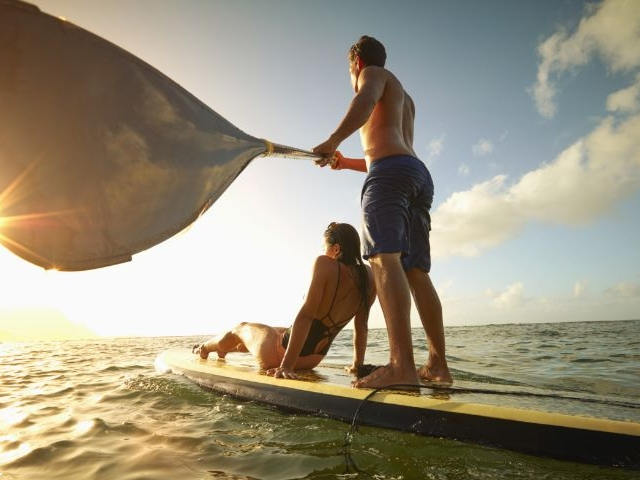 A Couple Enjoying the Sunset on a Stand-up Paddle Board at Isla Bella Beach Resort in the Florida Keys