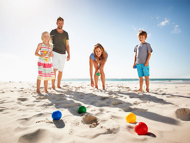 A Family Enjoying the Sun and Sand, Playing Bocce at Isla Bella Beach Resort in the Florida Keys