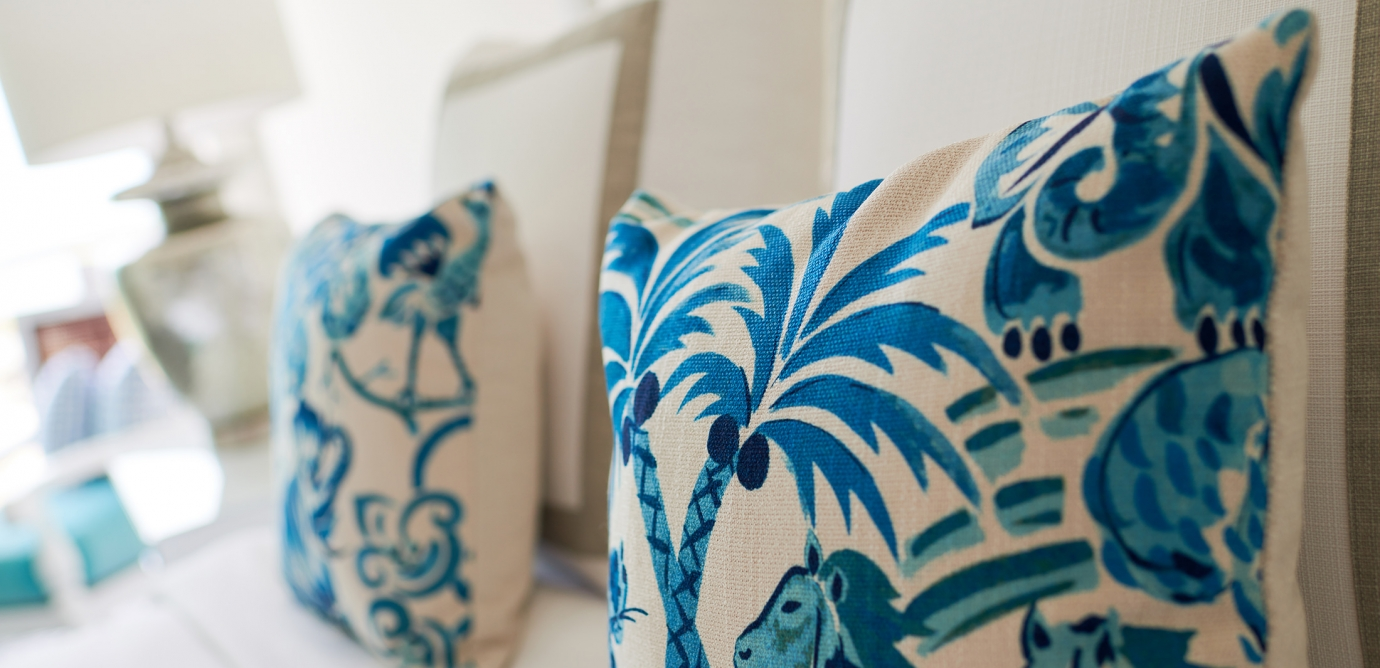 Blue and White Painted Tropical Pillows from an Isla Bella Oceanview Suite