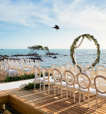 chairs and altar arranged for a beachfront wedding
